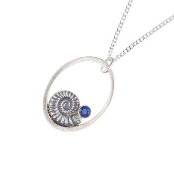 Ammonite pendant with kyanite