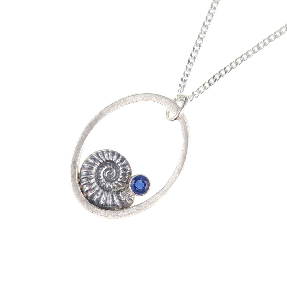 Ammonite pendant with kyanite