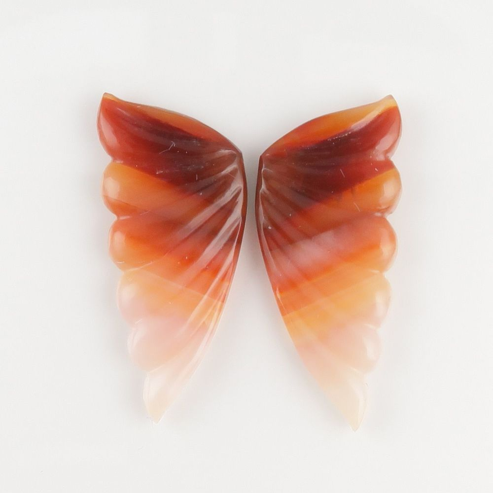 Carved agate wing slices – mirror pair