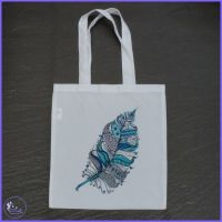 Feathers in Blue Tote Bag.