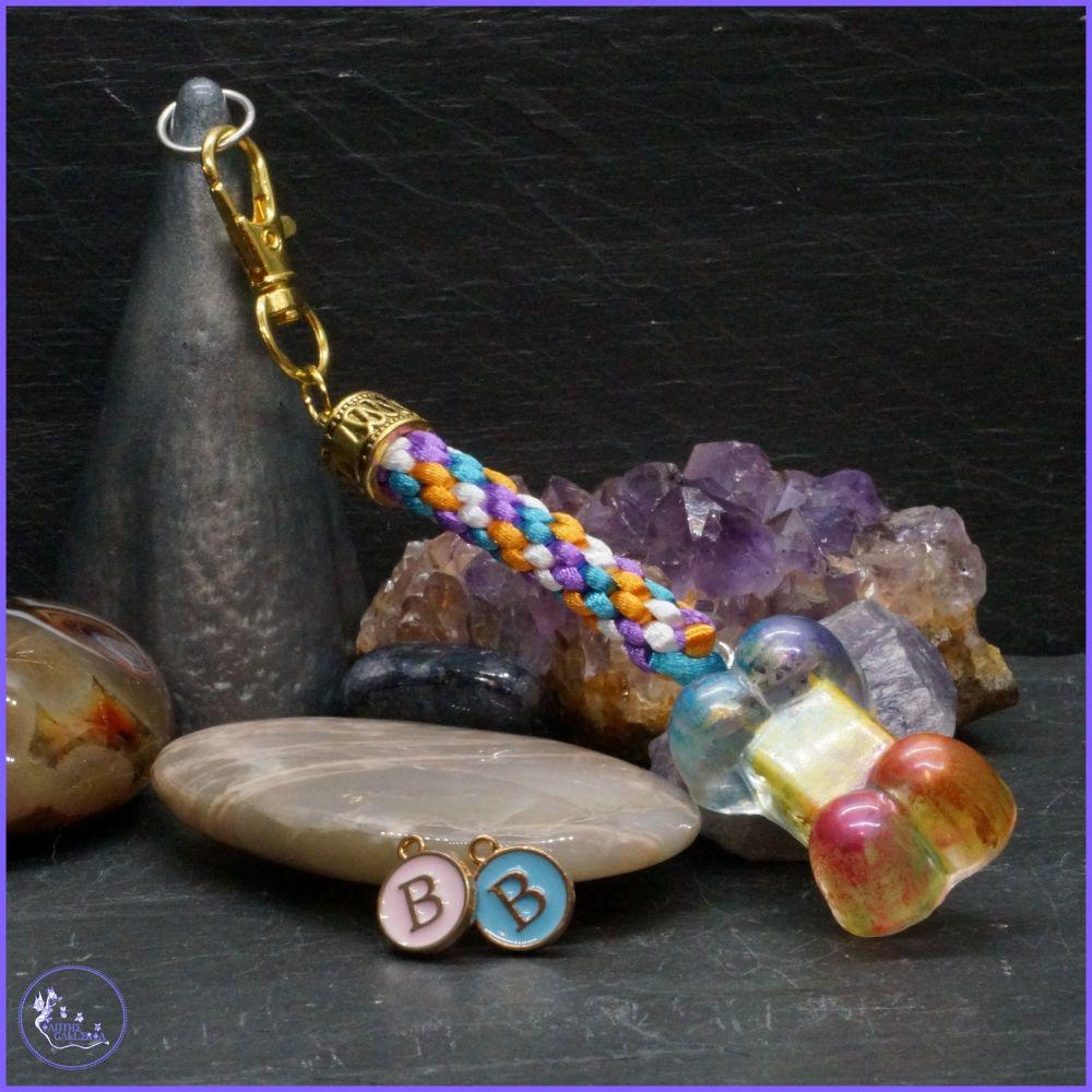 Rainbow Bone Medallion on a Multi Coloured Rainbow Kumihimo braid.