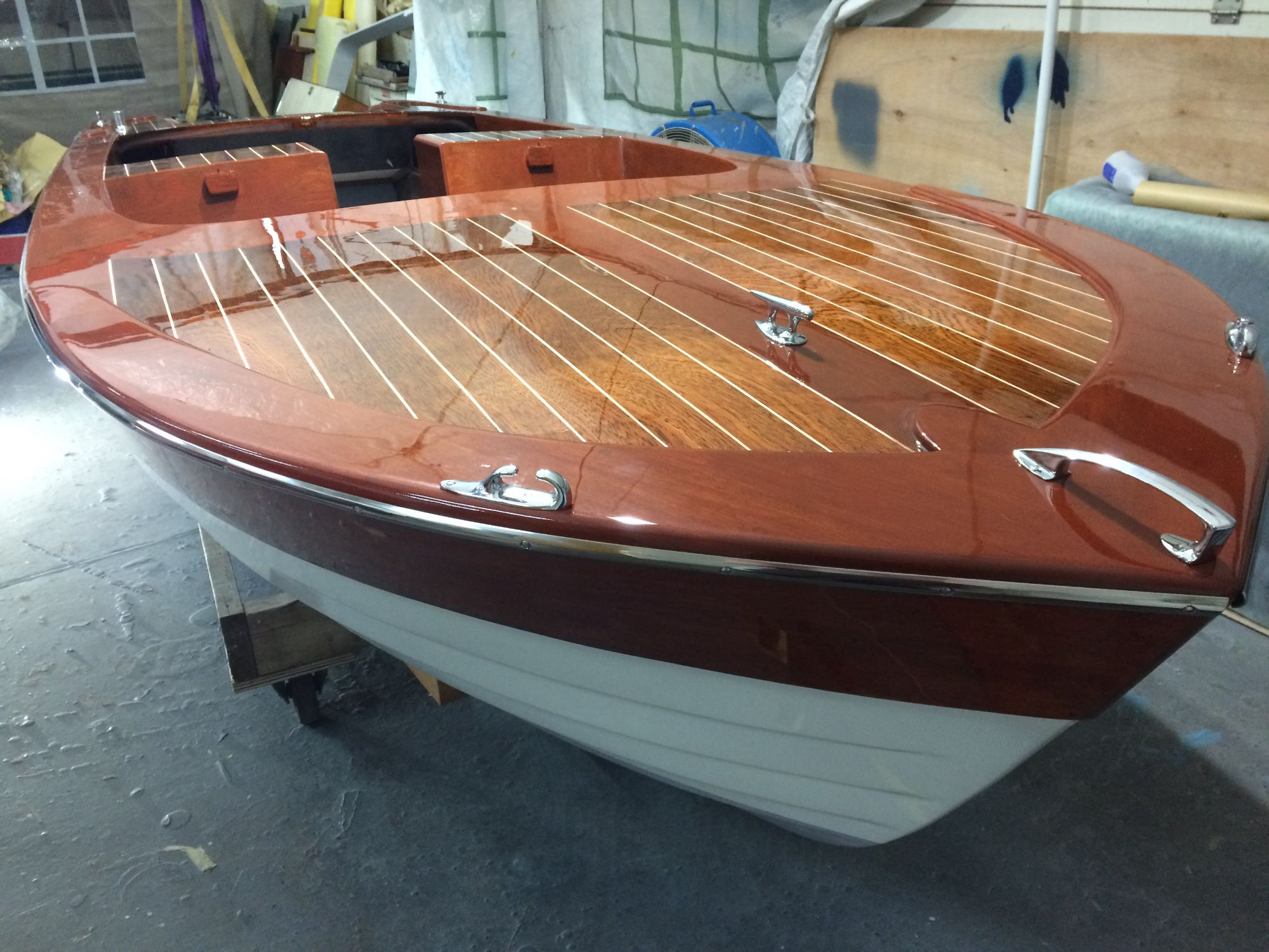 marine gloss varnish on a broom viking at fine wooden boats workshop