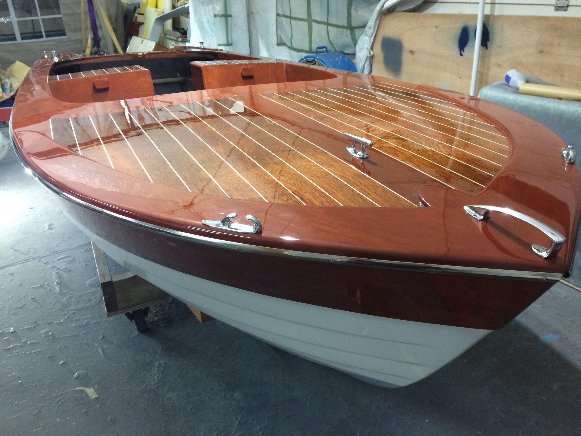 marine gloss varnish on a broom viking at fine wooden boats workshop