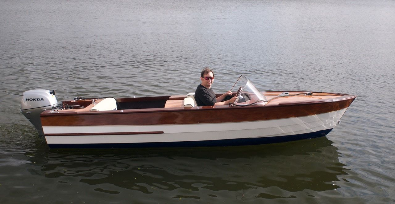 Thomas Neale at the helm of a broom boat
