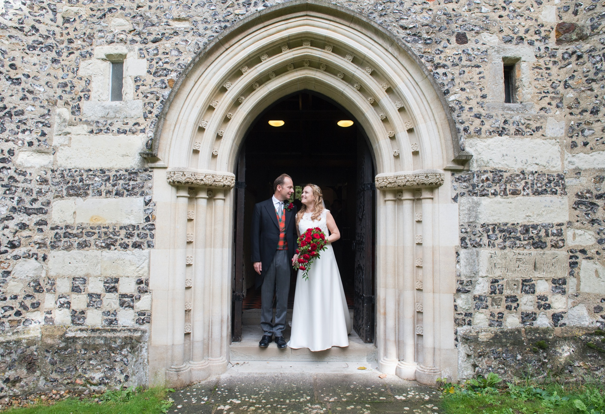 Couple at West door of St Mary's by Dale Cherry