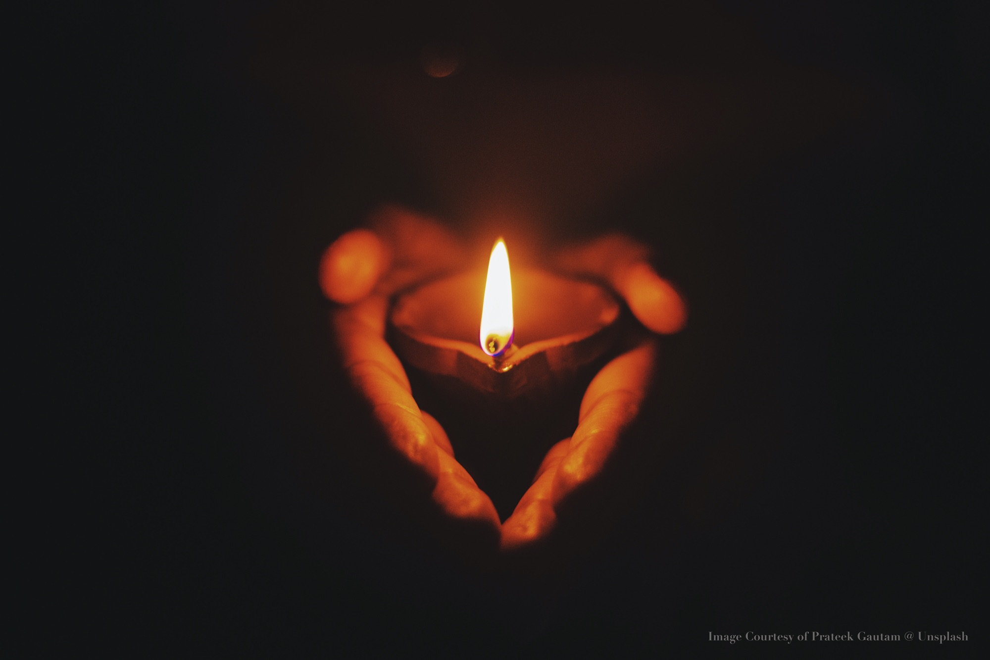 Hands holding a candle photograph by Pateek  Gautam on Unsplash