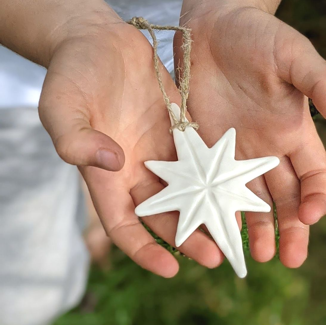 Hand-carved North Star Christmas Bauble Decoration.