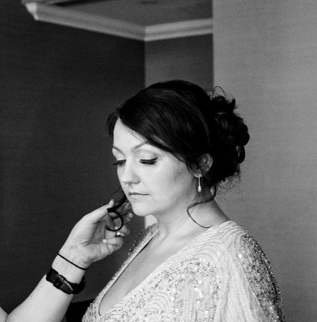 Adding the finishing touches to my gorgeous bride