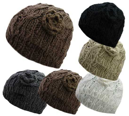 HAI756, Ladies cable knit hat with a flower design £1.00.  pk12..