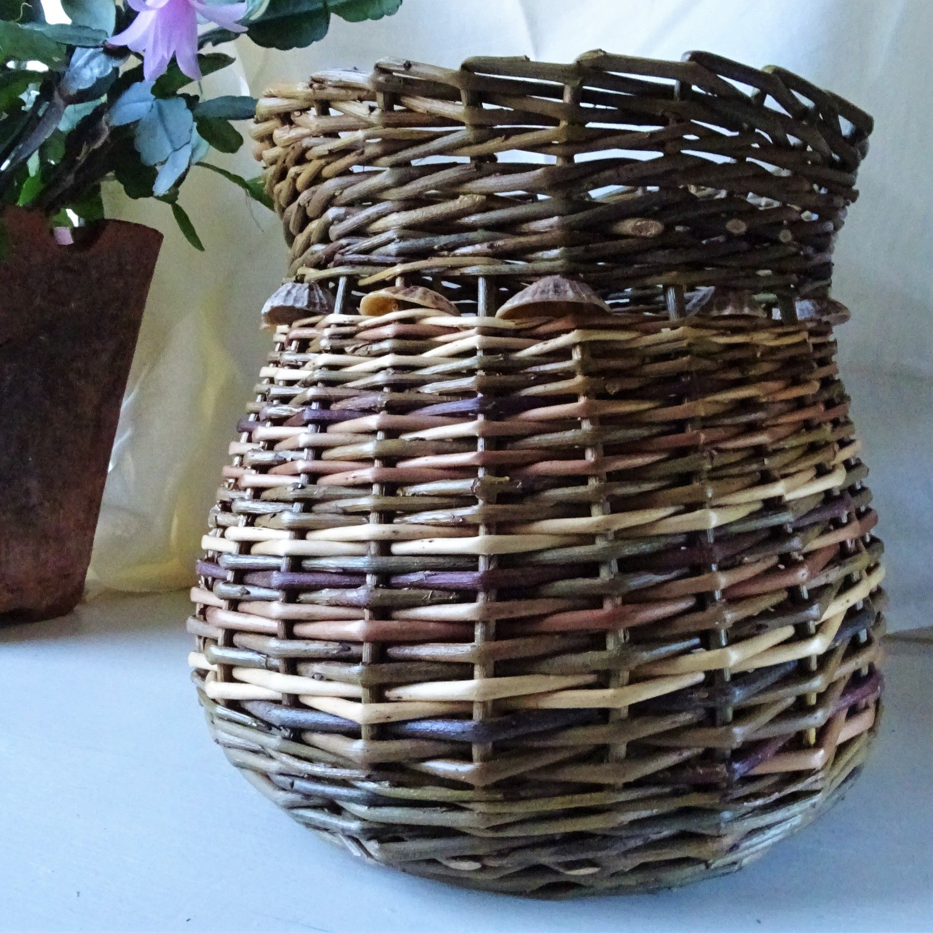 Part of a hand woven basket with shells