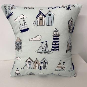 Beach hut & light house cushion - baby blue