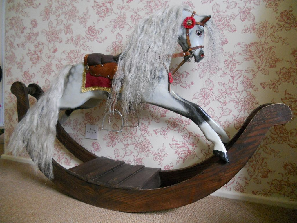 Pretty dapple grey bow rocking horse of a small size