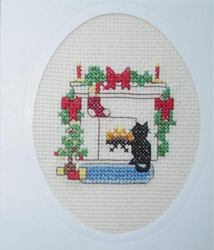 Christmas card - cat sat by the fire
