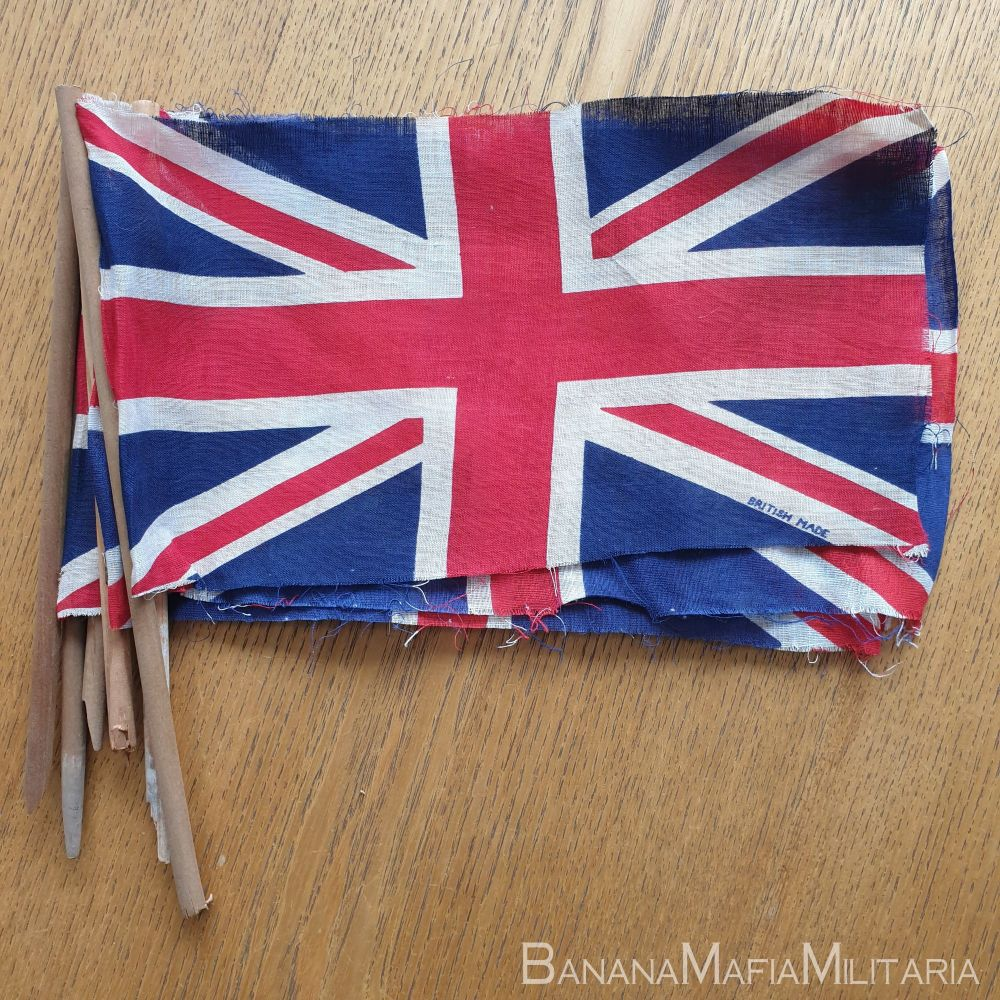 VE day flags (on broken hand held pole) printed and marked British made.