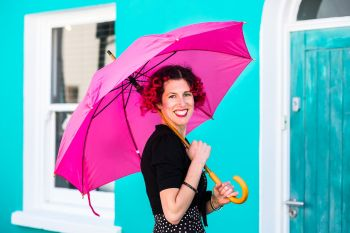 Photo of a lady with a pink umbrella