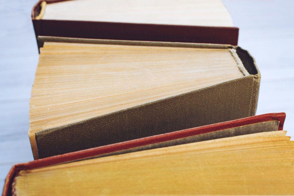 book-background-top-view-of-open-hardback-books-on-YKFDYU9