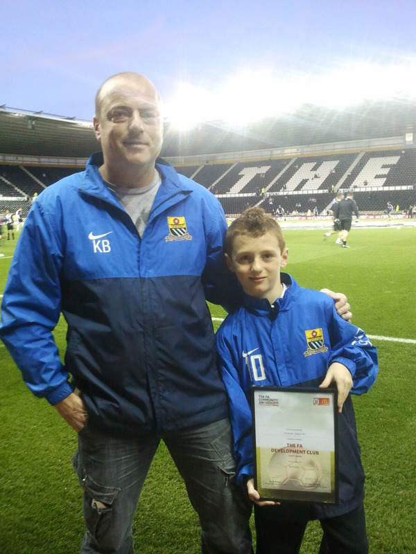 Kevan receiving development club of the year award