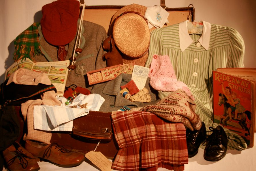 authentic 1940s clothing and artefacts representing the travels of a girl and boy evacuee