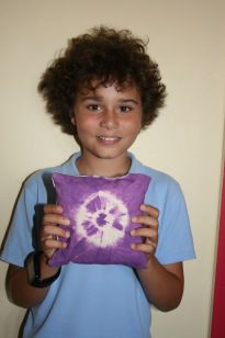 Boy pupil from Patcham Junior School displaying cushion made in Gladrags Sew-Easy workshop