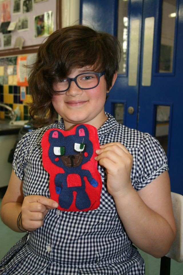 Girl pupil from Coombe Road Primary School displaying felt soft toy made in Gladrags Sew-Easy workshop