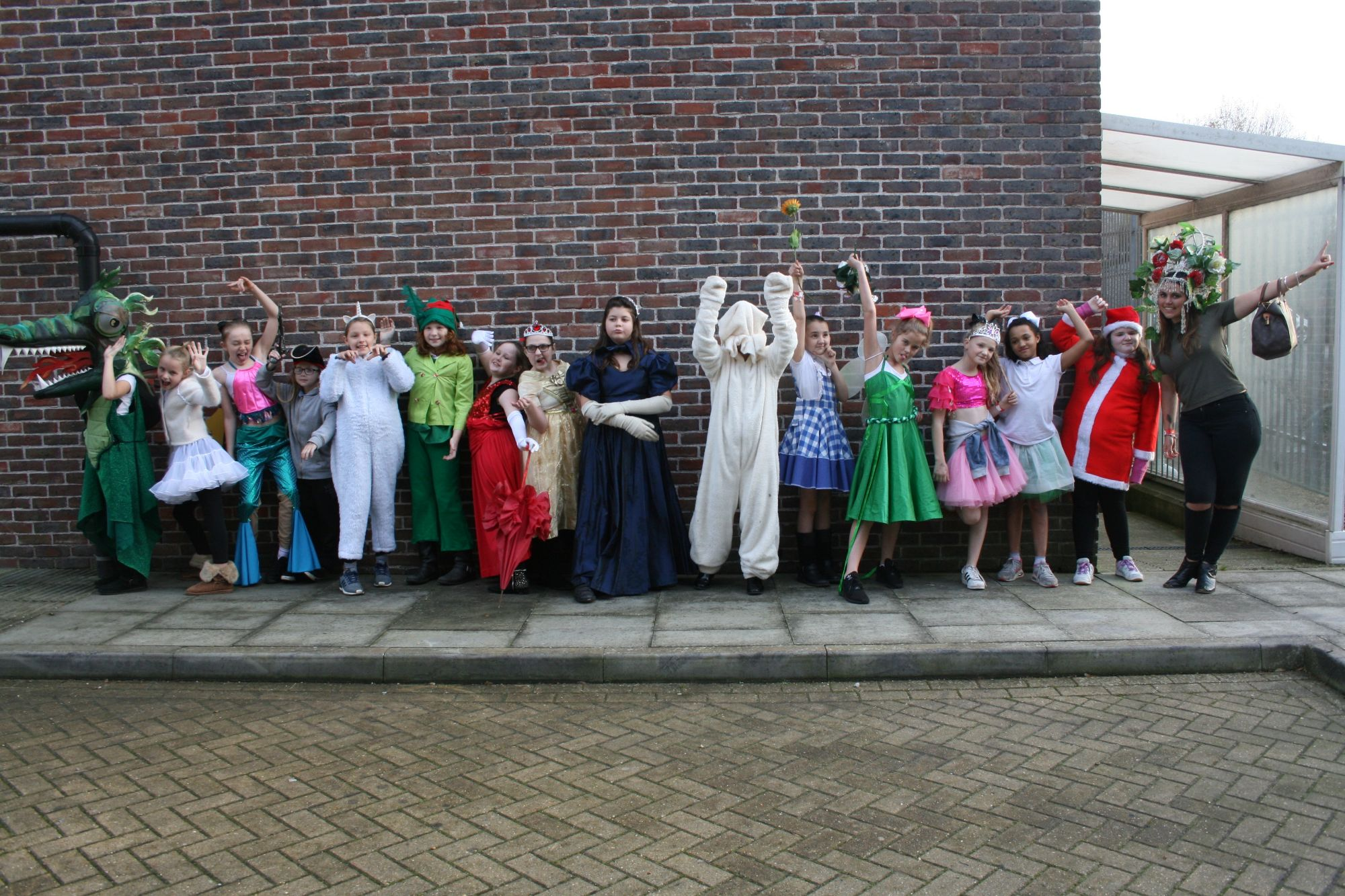 Group of pupils from Moulsecoomb Primary School in costume outside the Gladrags store