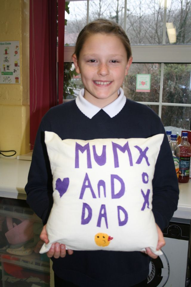 Girl pupil from Moulsecoomb Primary School displaying cushion made in Gladrags Sew-Easy workshop
