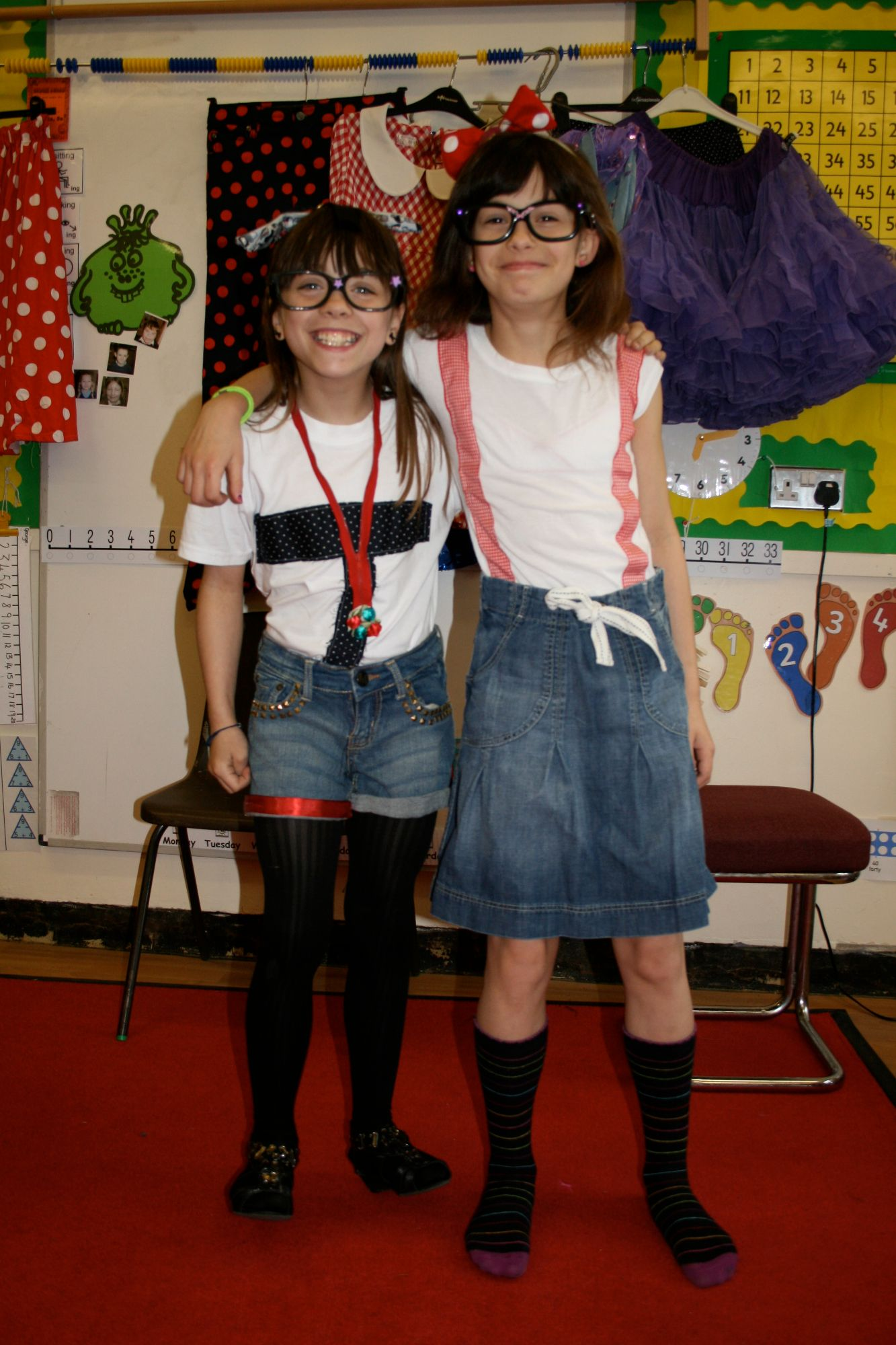 Girl pupils from Coldean Primary School posing in T-shirts they restyled at Gladrags Recycled Fashion workshop