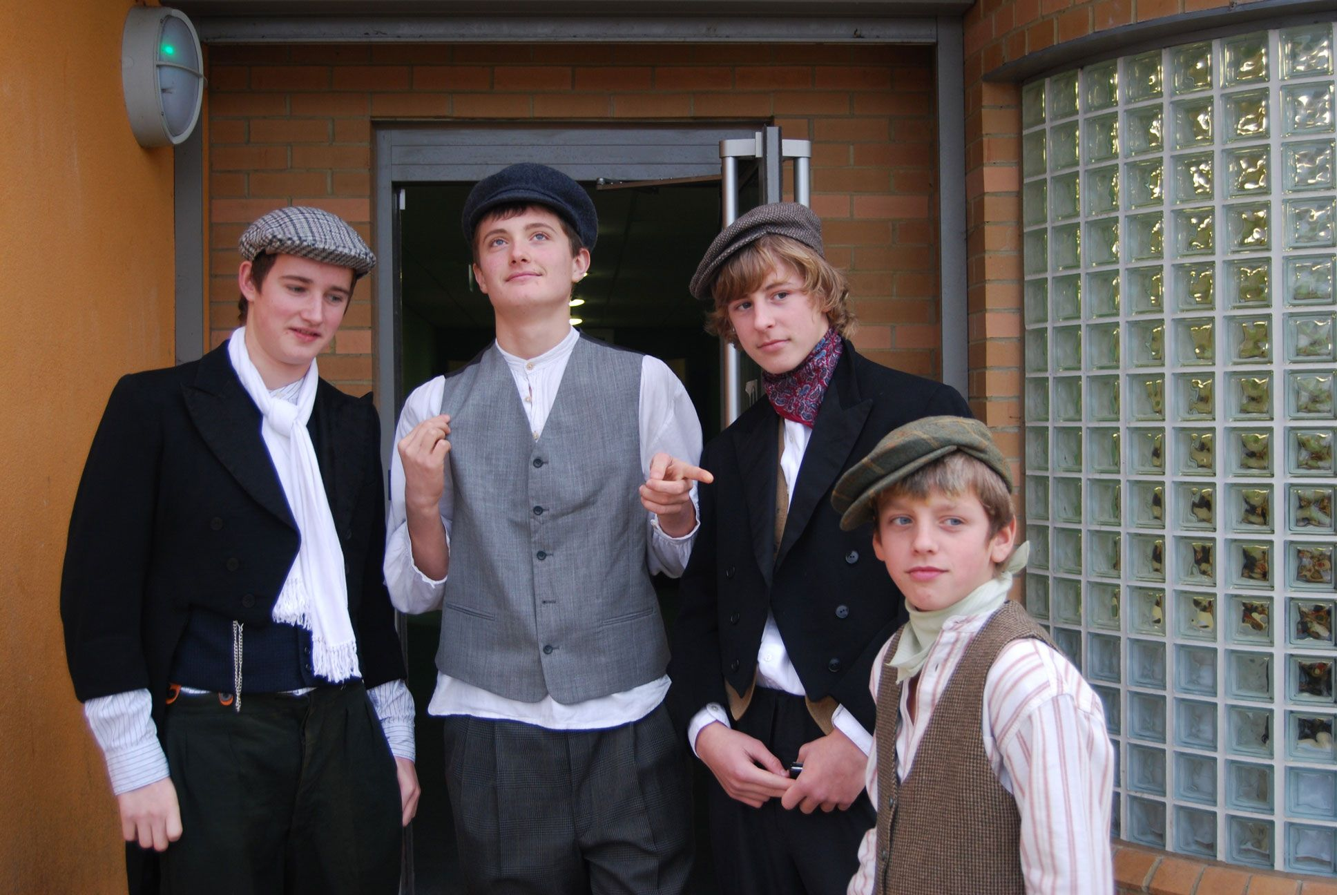 Four boys from Crew Club, Whitehawk in Victorian costume for Christmas dinner offered to elderly neighbours
