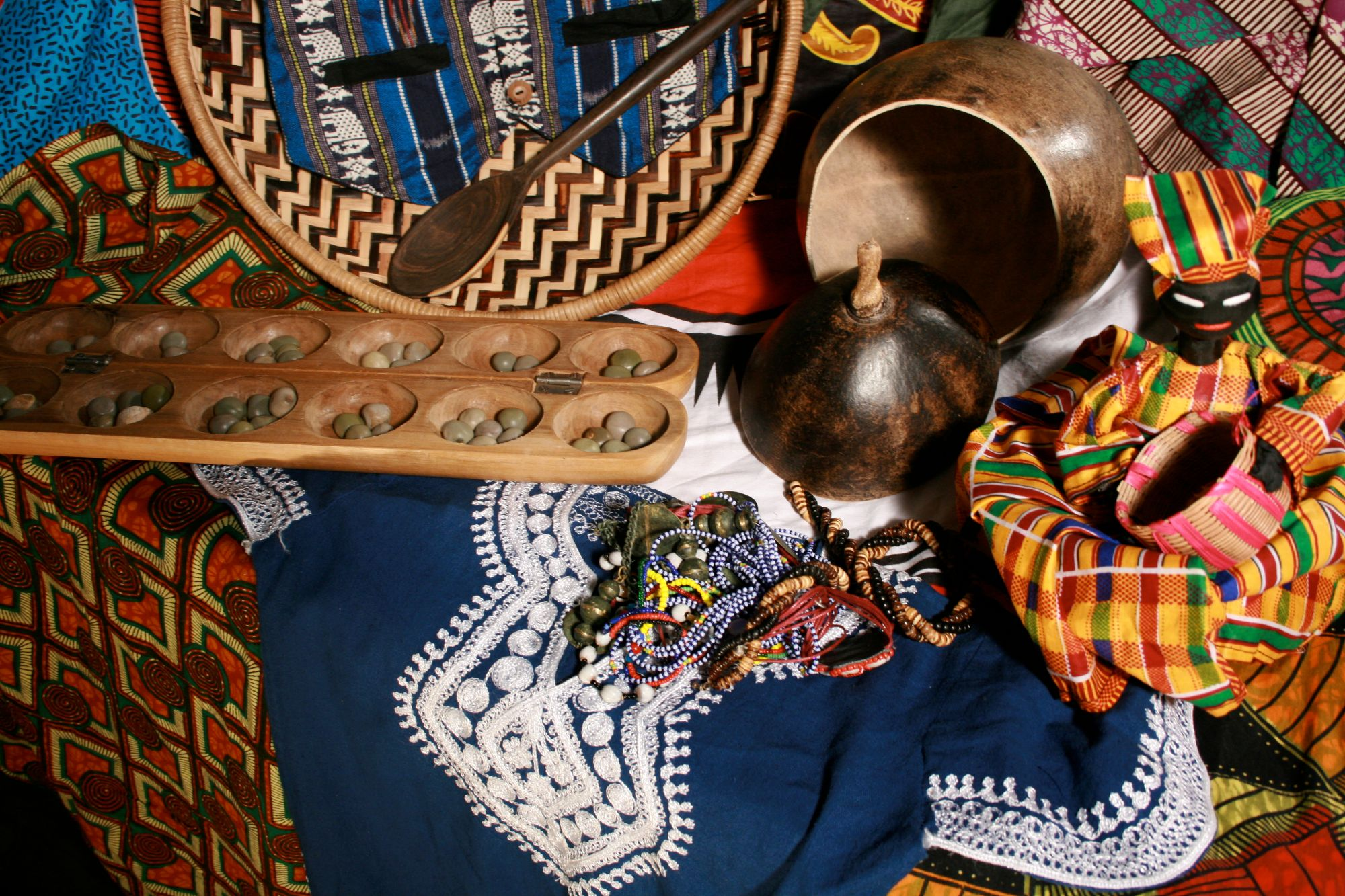 selection of colourful african garments and props