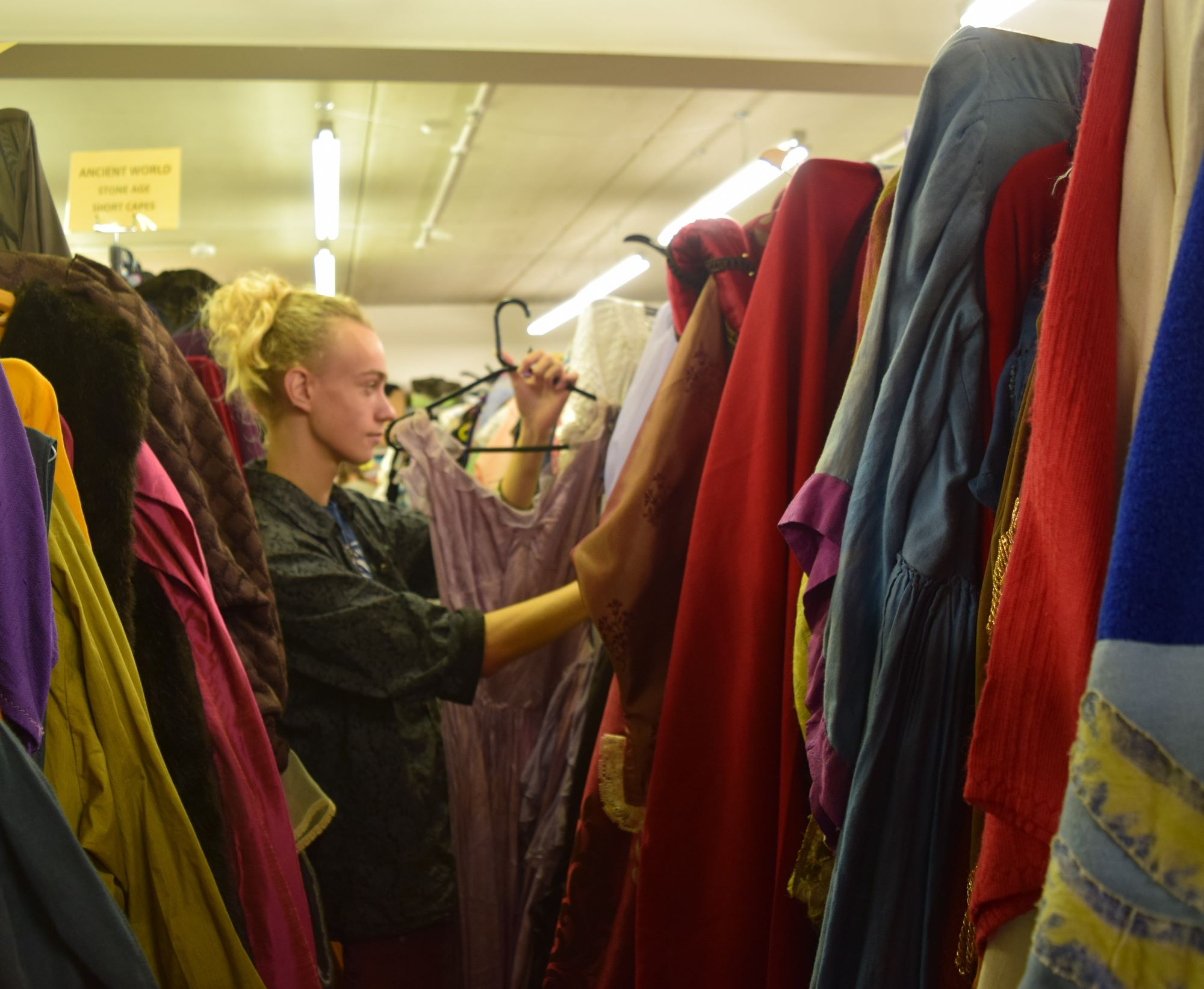 Jonah reorganises Victorian and Edwardian dresses   ready for new customers to view.
