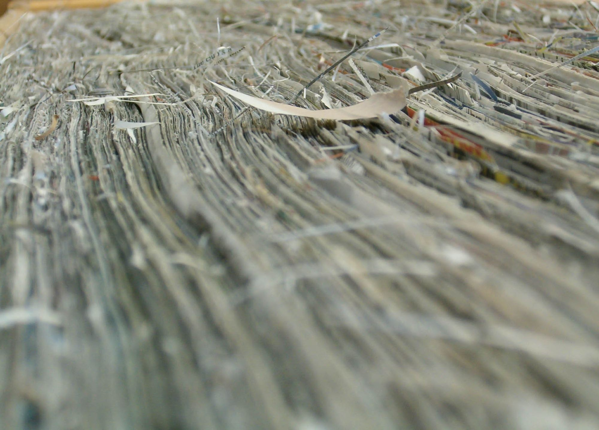 detail of artwork by Tracey Falcon title, Threads. Made of newspaper