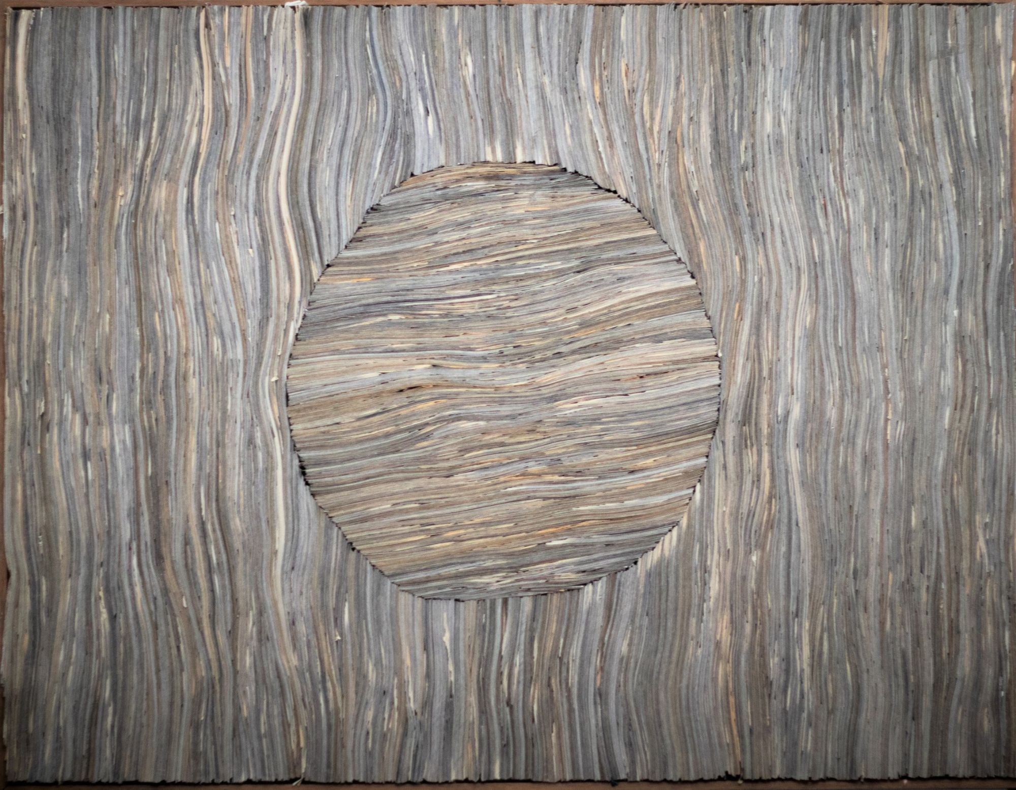 newsapaper artwork by Tracey Falcon, title PRESS newspaper strips tightly packed to resemble wood with a large circle in the middle