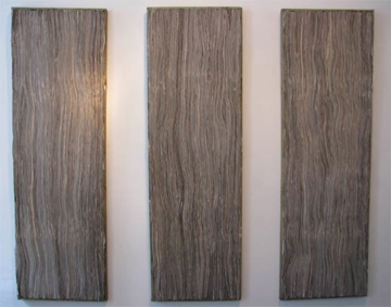 newsapaper artwork by Tracey Falcon, title SENTINELS.  3 panels of newspaper strips laid to resemble wood