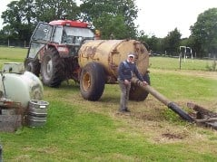 Farmer emptying a septic tank