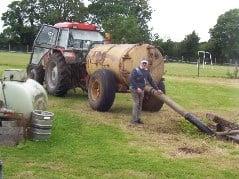 Farmer emptying a septic tank