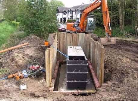 Apex sewage treatment plant, 50 persons, being installed in a high water